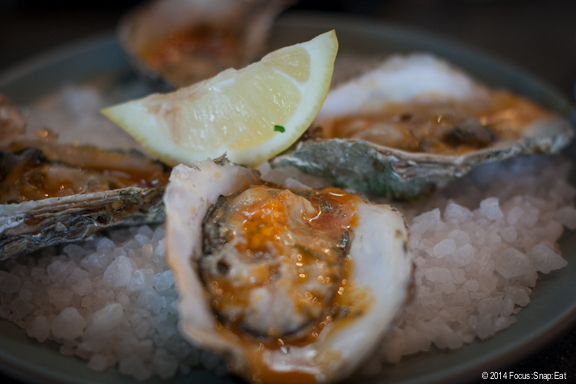 Grilled Sriracha oysters with lime and cilantro butter ($13 for four) didn't have much kick despite the name.