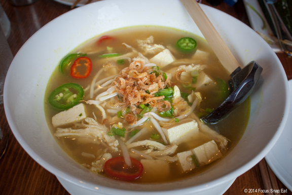 Soto Ayam ($12.50) is an Indonesian noodle dish in a clear curry chicken broth, with tofu, sprouts, chilies, scallions and fried shallots.