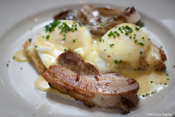 My plate of two poached eggs on toast with pork belly, roasted chicories and mustard hollandaise ($16)