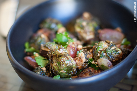 Flavorful dish of fried Brussels sprouts ($11) with grapes, kimchi puree, lemon and hazelnut.