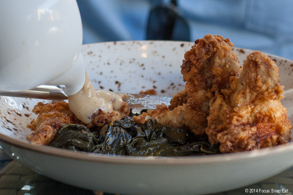 Jason poured the bacon-black truffle gravy over his buttermilk fried quail dish ($18), which he loved.