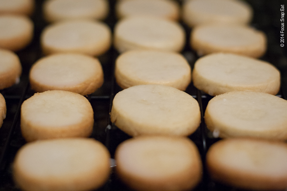 Lemon cookies freshly glazed and cooling off on the rack.