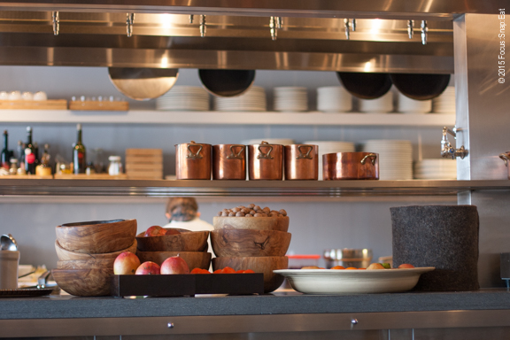 The stylish counters and shelves surrounding the open kitchen