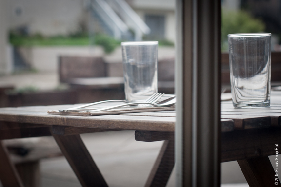 A window view of the outdoor tables
