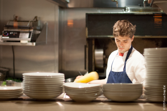 One of the chefs working in the open kitchen
