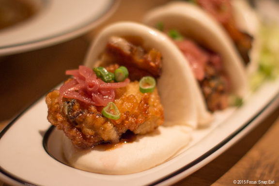 Oyster po bao ($14) are steamed buns with pork belly and fried oysters