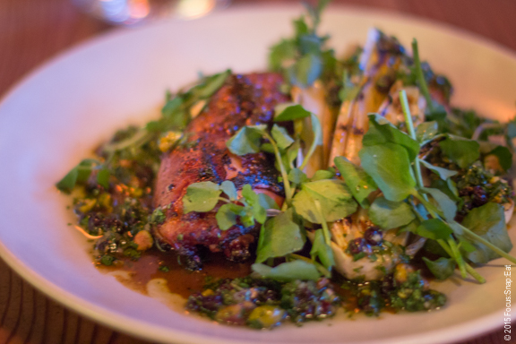 Tender braised tagine chicken leg with grilled Belgian endive, currants, pistachios and cilantro ($24)