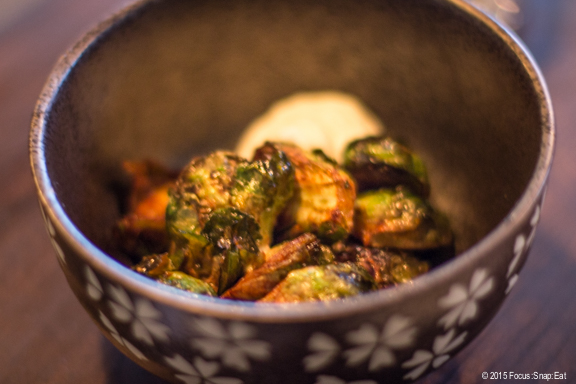Glazed Brussels sprouts with smoked ricotta
