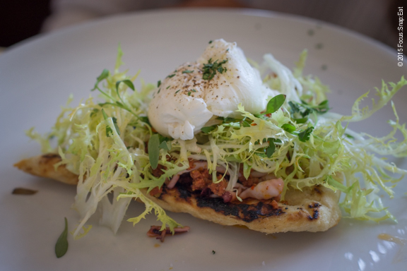 My niece ordered the grilled calamari and chorizo flat bread with poached egg and salmon roe ($14), which she enjoyed.
