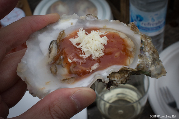 Oyster with cocktail sauce with freshly grated horseradish