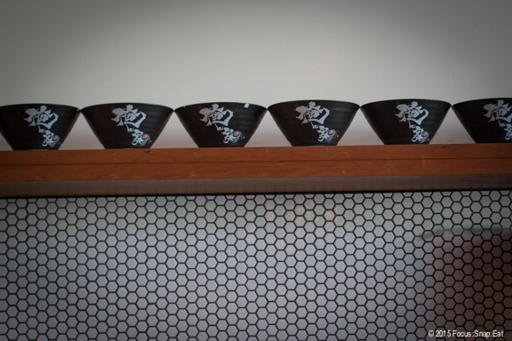 Shelf of bowls along one wall.