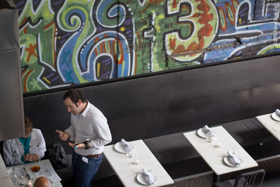 The dining room with graffiti mural
