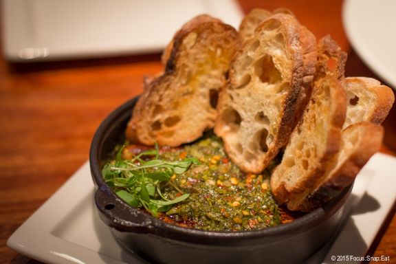 Roasted manchego ($13) sits underneath the ginger chimichurri and blends with saffron oregano bechamel