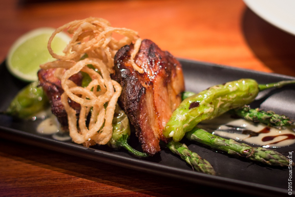 Seared pork belly ($16) with pine nut butter, spicy demi, fried padrons, and citrus asparagus