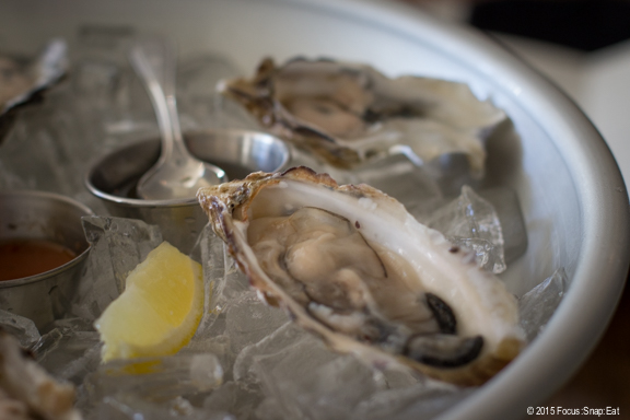 $1 oysters during happy hour, comes with a tarragon mignonette
