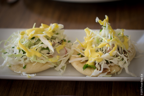 Pork cheek fry bread tacos ($4.50 each) is tender pork cheeks in jerk rub piled on with slaw and mango vinaigrette.