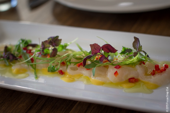 Scallop crudo ($15) with yuzu, passion fruit emulsion, chili, cilantro and shiso.