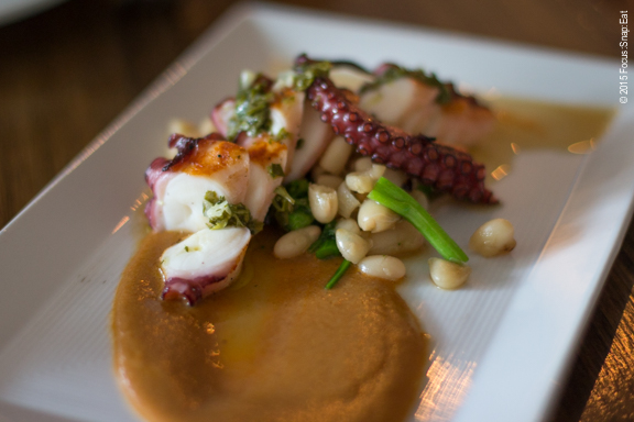 Grilled octopus ($15), with warm white bean salad, chorizo sauce, and salsa verde.