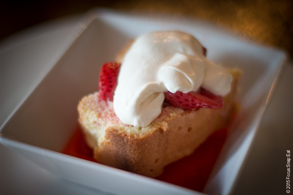 Tres leche cake ($8) with champagne poached strawberries, dulce de leche and whipped cream.