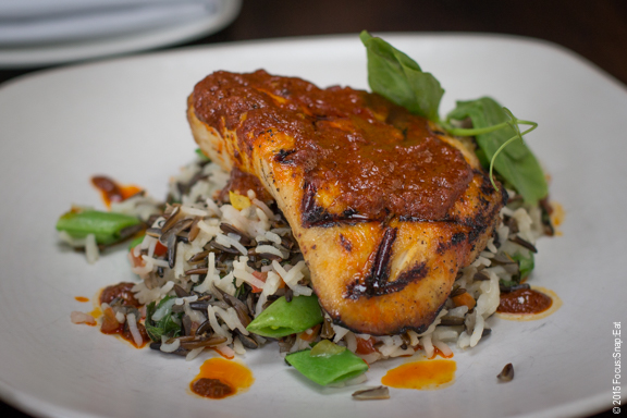 Grilled Hawaiian walu (a meaty white fish) with sugar snap peas, wild rice, mint, and curried sesame salsita ($25)