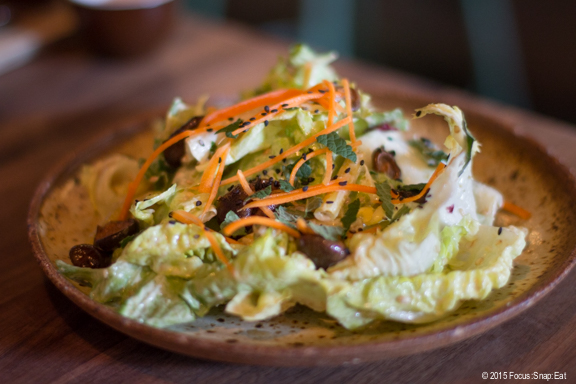 Little gem salad ($13.50) with romano and wax beans, carrots, pickled shiitake mushrooms, anise hyssop and goma-ae