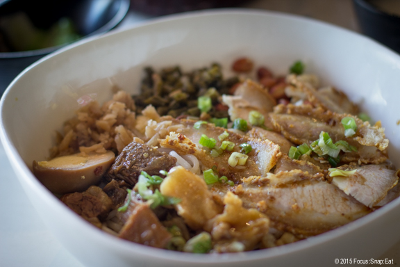 My bowl of classic Guilin noodles topped with beef brisket and crispy pork.