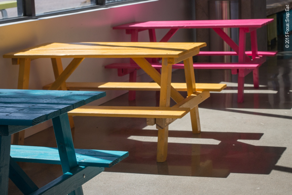 Brightly colored benches inside