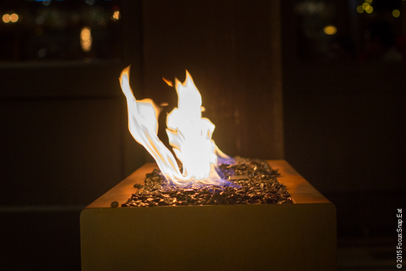 Stone fire pit provides a warm welcoming at the entrance of Caputo.