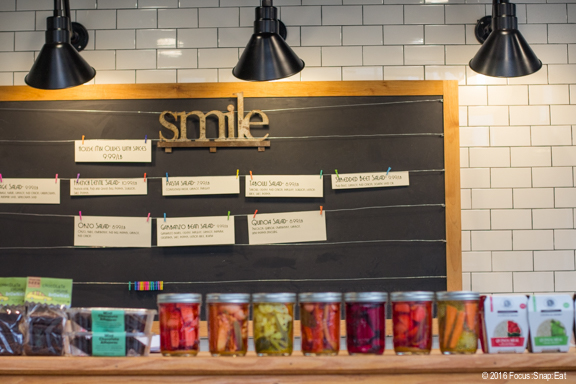 A blackboard in the tiny deli section displaying featured items for sale, which comes from the Spice Monkey kitchen next door.