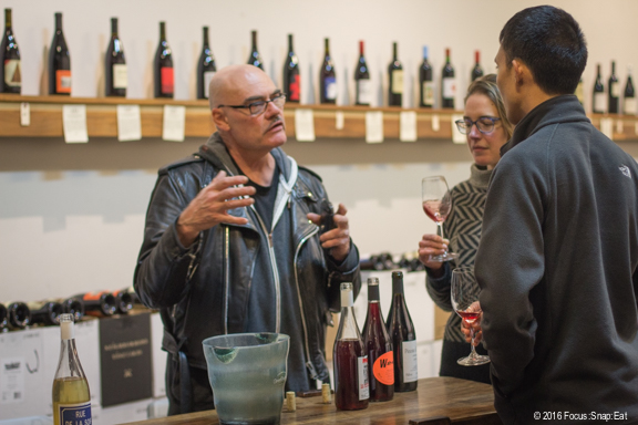 Winemaker Brendan Tracey, left, chatting with customers during a wine tasting inside Vintage Berkeley's Elmwood store.