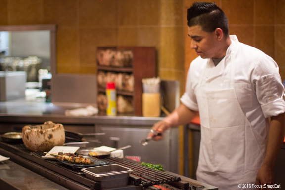 A chef working the robata grill at Ozumo