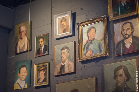 One of the walls with eclectic collection of portraits.