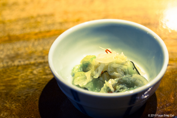 Bowl of complimentary pickled vegetables to whet your palate before dining at Hina Yakitori.