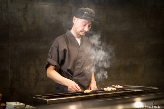 Tommy Clearly mans the charcoal grill station, which imports Japanese binchotan charcoal