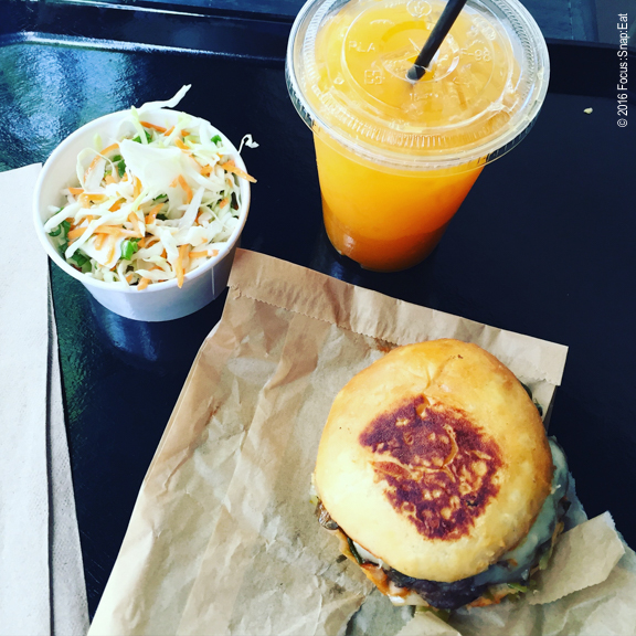 From top right: cole slaw, apricot aqua fresca, and Locol cheeseburg