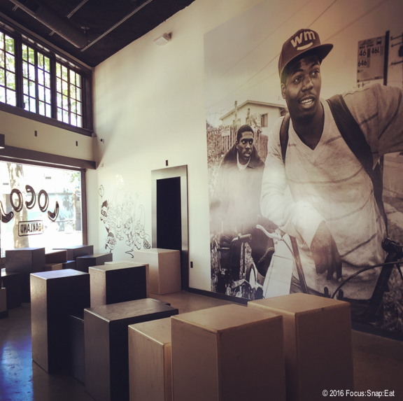 The large mural and open seating area at Locol