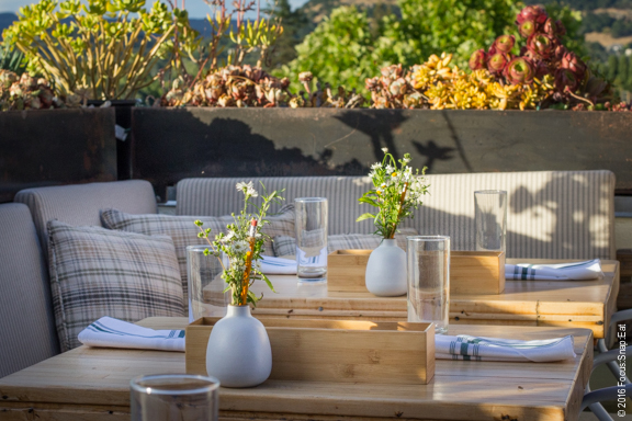 The patio with the golden sunset light accentuating the setting.