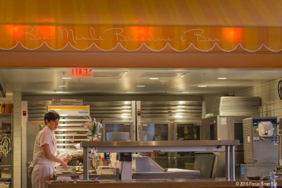 A view of the open kitchen with orange stripped awnings.