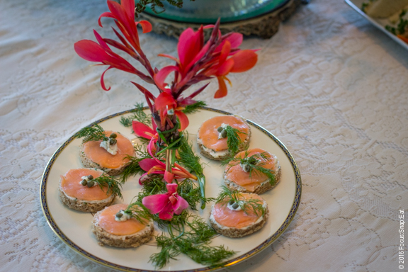 Smoked salmon with a towering floral centerpiece.
