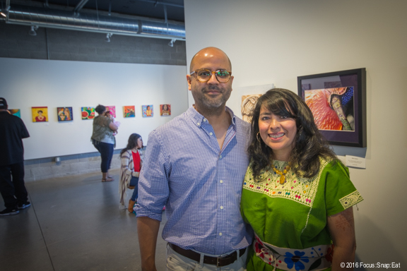 Tim and Maria Sanchez, owners of the new Tertulia Coffee and Sanchez Contemporary Gallery, in the exhibit section of the gallery on their opening weekend.