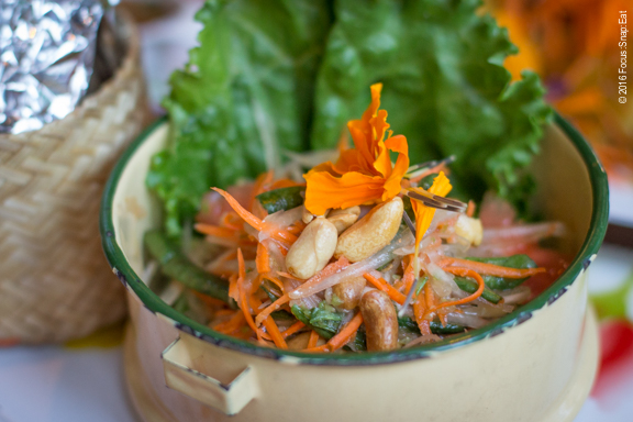 Papaya salad served along with sticky rice on the Gai Yang Som Tum chicken plate.