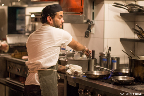 One of the chefs in the open kitchen
