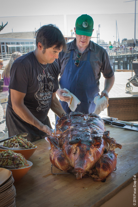 The crew from Chop Bar unveiling their whole roasted pig.