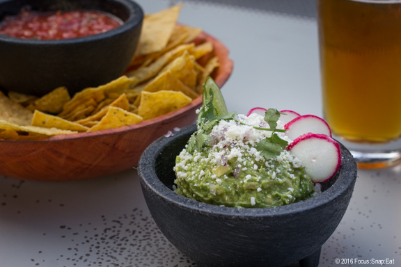 The fresh guacamole under an open rooftop.