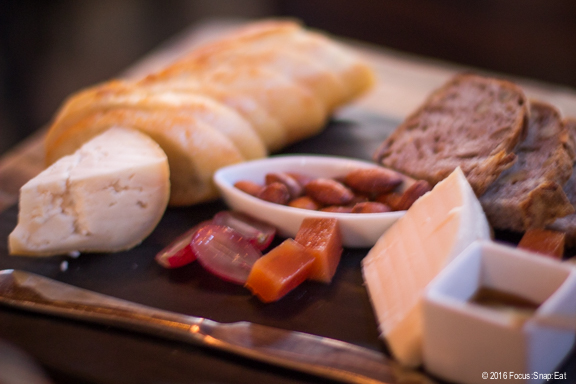 Cheese plate comes with nuts, grapes, bread and quince gels to complement your cheese selection.