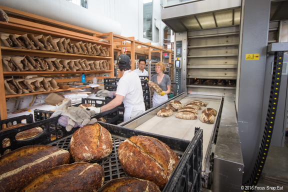 Freshly baked bread from the huge oven right in the center of the room.