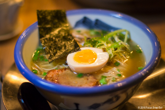 Signature Yuzu Shio ramen ($15) with salt tare, yuzu citrus squeeze, chicken broth, shimeji mushroom, seasoned egg, chashu, endive and nori seaweed.