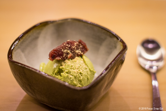 Last course of matcha ice cream with a dollop of azuki red bean on top.
