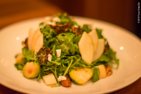 Brussel sprout salad ($12) with herbed goat cheese, walnut, asian pear, arugula and pear vinaigrette.