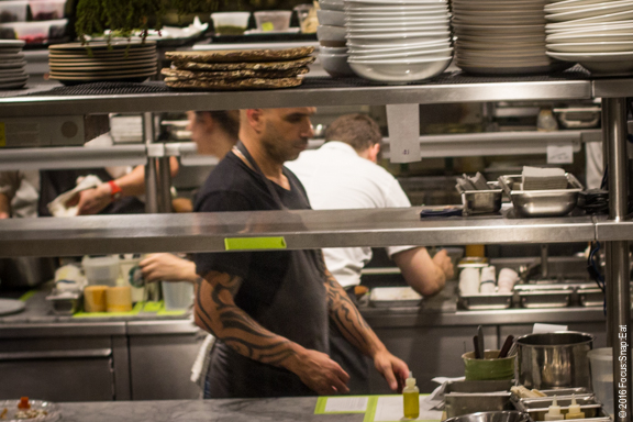 Peek of Chef Mourad Lahlou in the large kitchen, which you can see walking upstairs.